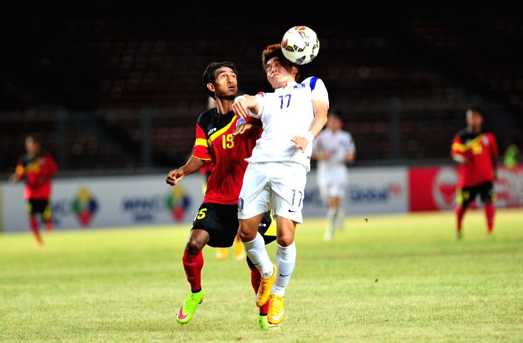Moon Changjin (R) of South Korea vies for the ball against Agostinho of Timor Leste during the qualification match of Group H at the AFC U-23 Championship 2016 at ...