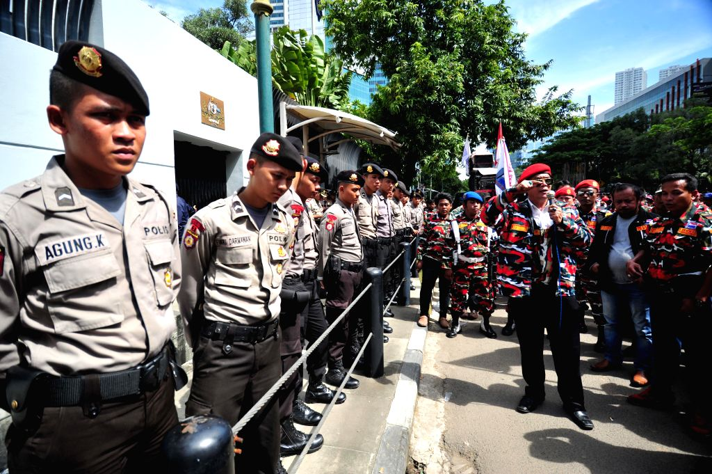 Policemen stand guard during a group support action of the Indonesian government's policy to combat narcotics in front of Australian Embassy in Jakarta, Indonesia, ...