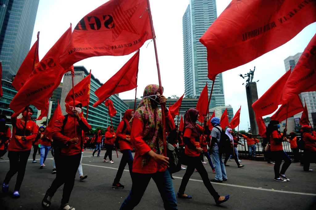 Indonesian workers march to the Presidential Palace during a rally on International Labor Day in Jakarta, Indonesia, May 1, 2015. Thousands of workers in Indonesia ...