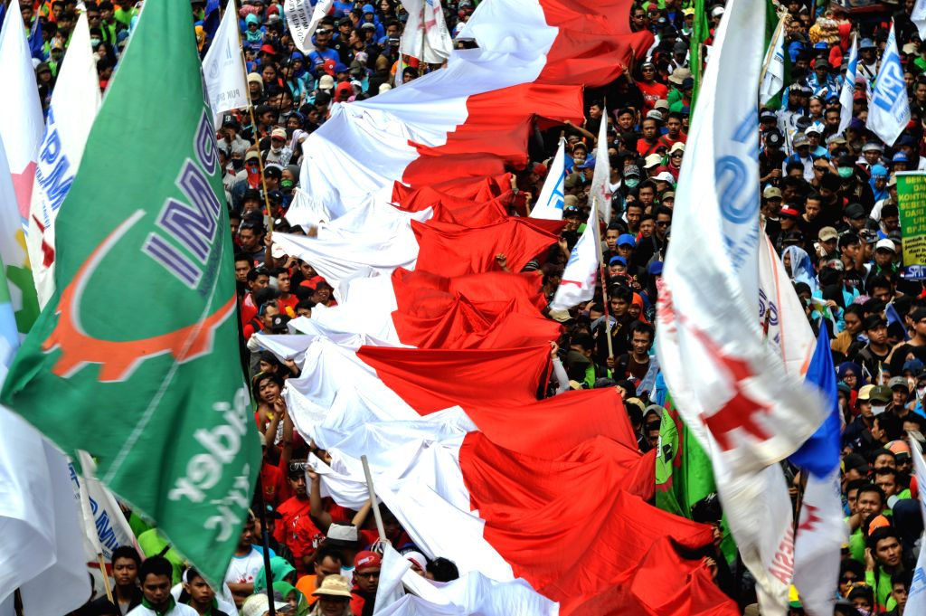 JAKARTA. May 1, 2015 Labors carry a giant Indonesian national flag during a celebration marking International Labor Day on Thamrin street in Jakarta, Indonesia, May 1, 2015. More than a ...