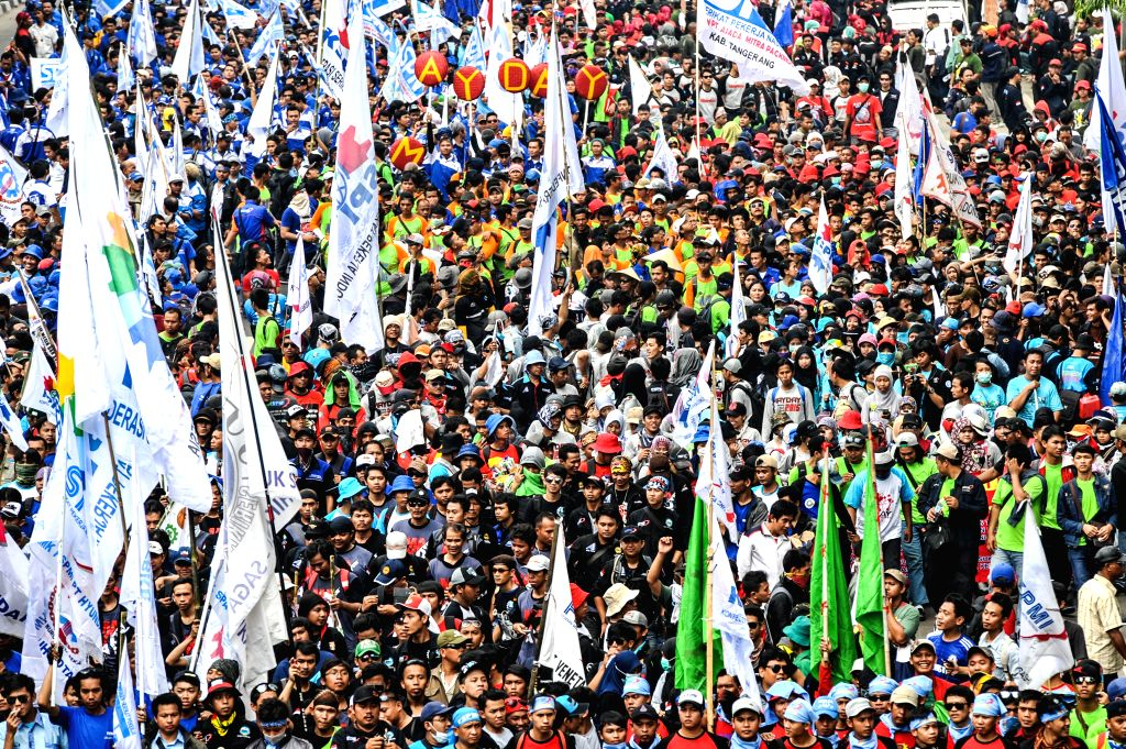 JAKARTA. May 1, 2015 Labors walk on the Thamrin street during a celebration marking International Labor Day in Jakarta, Indonesia, May 1, 2015. More than a hundred thousand of Indonesian ...
