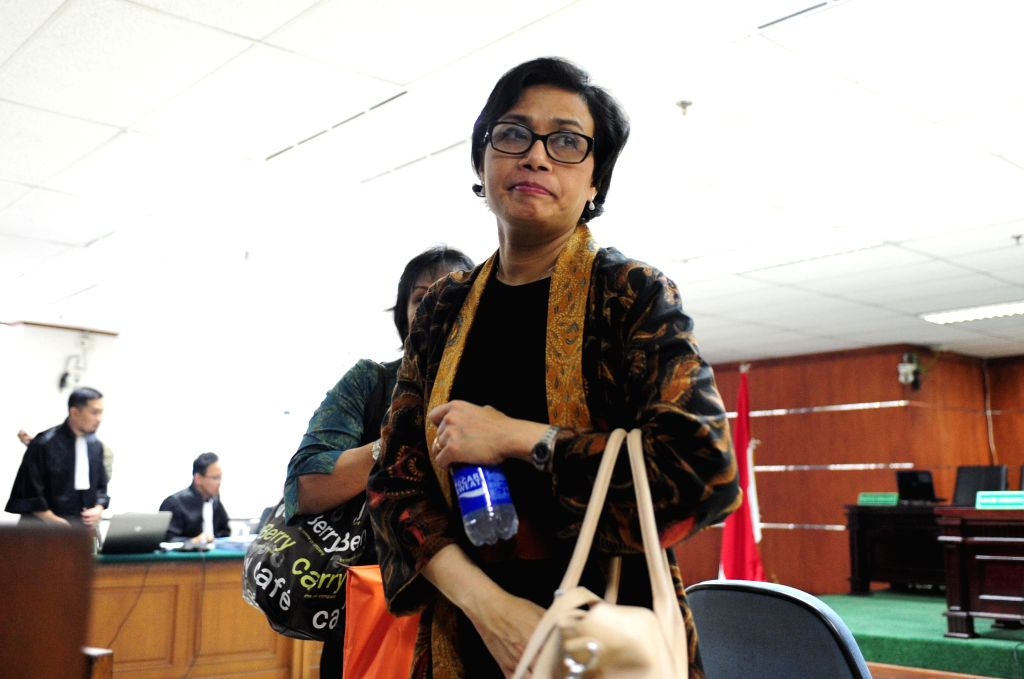 World Bank managing director and Indonesian former finance minister Sri Mulyani leaves a court room as she gives her testimony during a trial of a former deputy ...