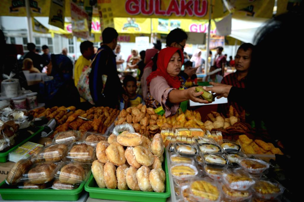 JAKARTA, May 30, 2017 - Indonesian Muslim people buy food for the holy month of Ramadan in Jakarta, Indonesia, May 30, 2017. During Ramadan month people refrain from eating, drinking and smoking from ...