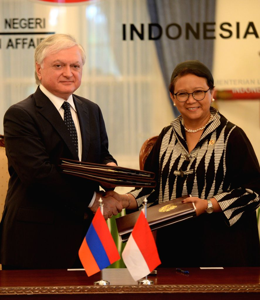 JAKARTA, Nov. 1, 2016 - Indonesian Foreign Minister, Retno Marsudi (R) changes documents with Armenian Foreign Minister Edward Nalbandyan after signing in Jakarta, Indonesia, Nov. 1, 2016. Armenian ... - Edward Nalbandyan