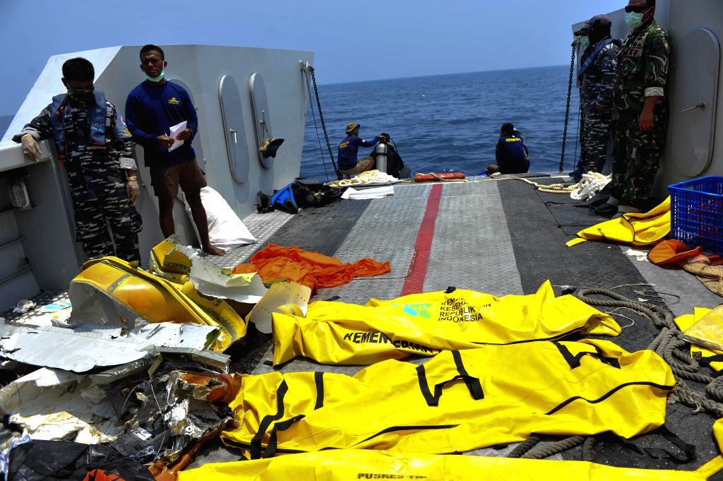 JAKARTA, Nov. 1, 2018 - Photo take on Nov. 1, 2018 shows body bags of victims of Lion Air JT610 lying on a landing craft at Tanjung Pakis offshore in Karawang, West Java Province, Indonesia. A black ...