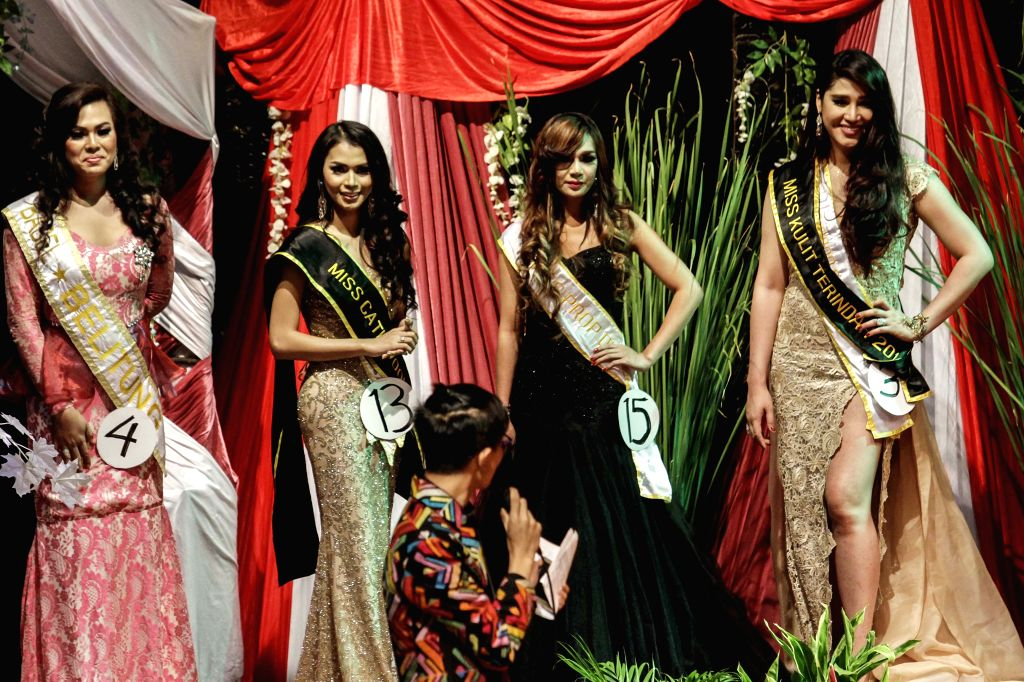 JAKARTA, Nov. 12, 2016 - Contestants smile during the crowning of the Miss Queen Contest 2016 in Jakarta, Indonesia, Nov. 11, 2016. A beauty pageant for transgenders was discreetly held in Jakarta to ...