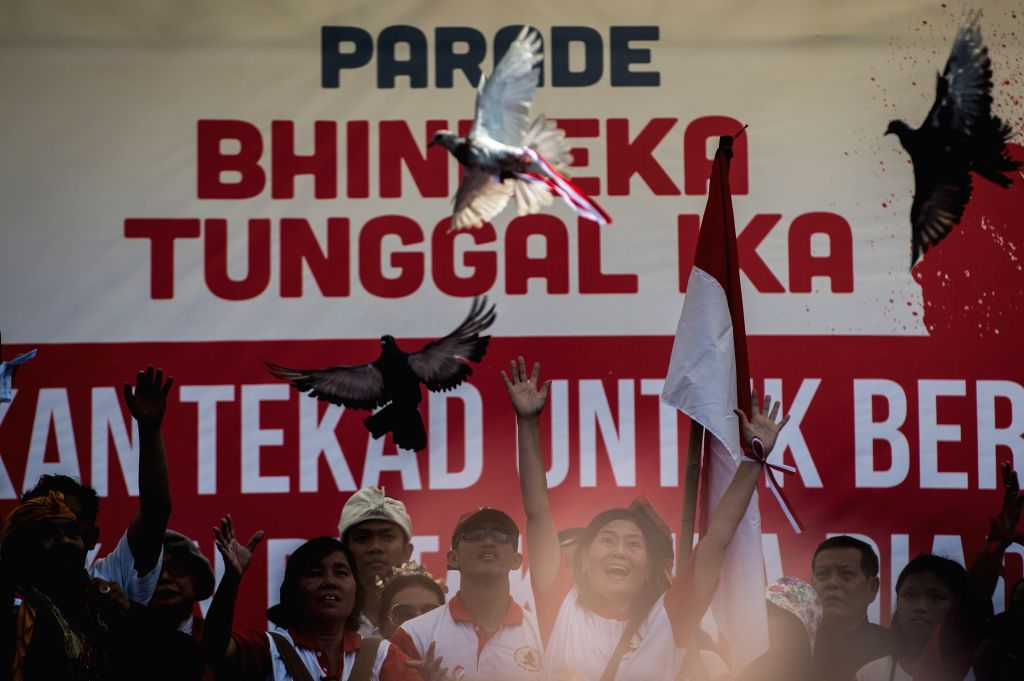 JAKARTA, Nov. 19, 2016 - Activists release pigeons during the Bhinneka Tunggal Ika (Unity in Diversity) Parade in Jakarta, Indonesia, Nov. 19, 2016. Hundreds of people staged the parade on Saturday ...