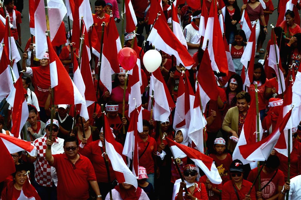 JAKARTA, Nov. 20, 2016 - People holding Indonesian national flags march during a peaceful rally to promote tolerance and unity in Jakarta, Indonesia, Nov. 20, 2016. People took part in a rally ...