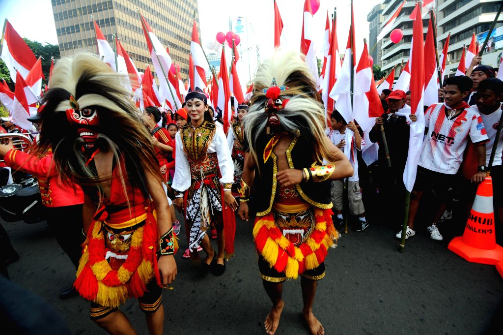 JAKARTA, Nov. 20, 2016 - People wearing costumes from East Java march during a peaceful rally to promote tolerance and unity in Jakarta, Indonesia, Nov. 20, 2016. People took part in a rally against ...