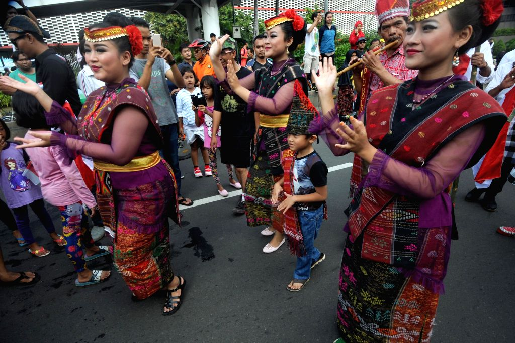 JAKARTA, Nov. 20, 2016 - People wearing North Sumatra traditional costumes participate in a peaceful rally to promote tolerance and unity in Jakarta, Indonesia, Nov. 20, 2016. People took part in a ...