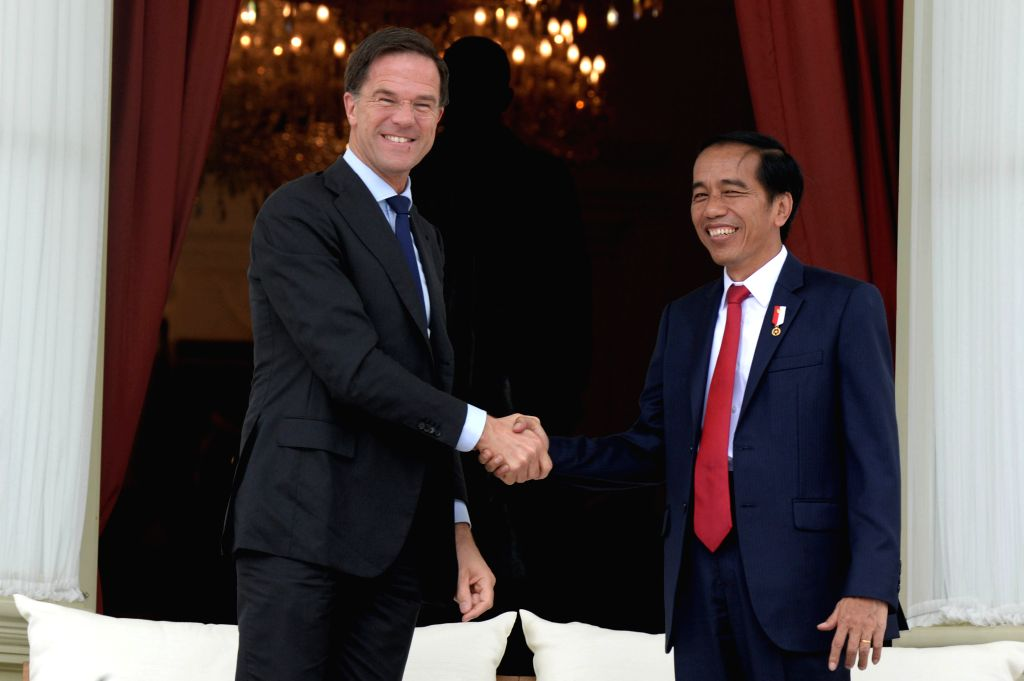 JAKARTA, Nov. 23, 2016 - Indonesian President Joko Widodo (R) shakes hands with Dutch Prime Minister Mark Rutte at the Presidential Palace in Jakarta, Indonesia, Nov. 23, 2016. Dutch Prime Minister ... - Mark Rutte