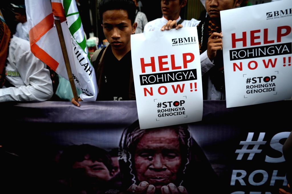 JAKARTA, Nov. 25, 2016 - Indonesian Muslims hold placards during a rally for Rohingya people in front of Myanmar embassy in Jakarta, Indonesia, Nov. 25, 2016. Protestors expressed serious concerns ...