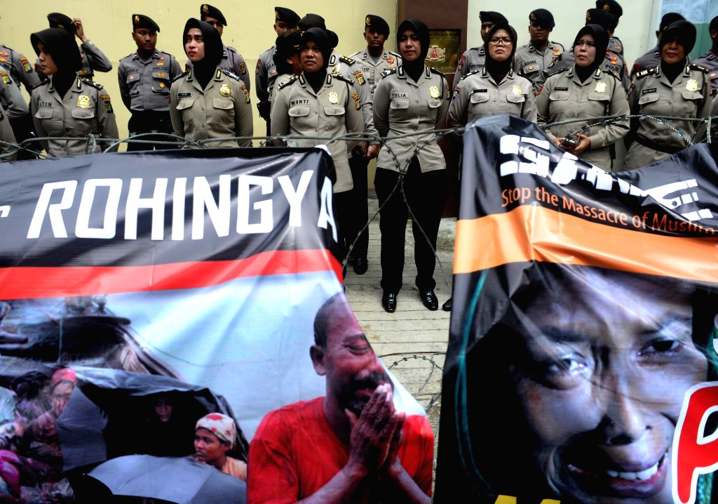 JAKARTA, Nov. 25, 2016 - Indonesian police officers stand guards during a rally for Rohingya people in front of Myanmar embassy in Jakarta, Indonesia, Nov. 25, 2016. Protestors expressed serious ...