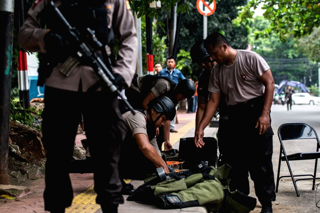 JAKARTA, Nov. 30, 2016 - Indonesian bomb squad inspects a suspicious object found at a bus stop in front of The City Tower, Jakarta, Indonesia, Nov. 30, 2016.