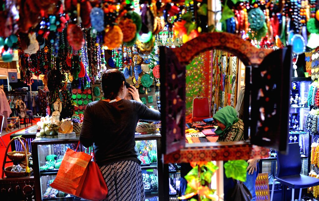 JAKARTA, Oct. 11, 2017 - A visitor looks at handicrafts displayed at the Crafina 2017 trade fair in Jakarta, Indonesia, Oct. 11, 2017. The trade fair featuring various ethnic Indonesian handicrafts ...