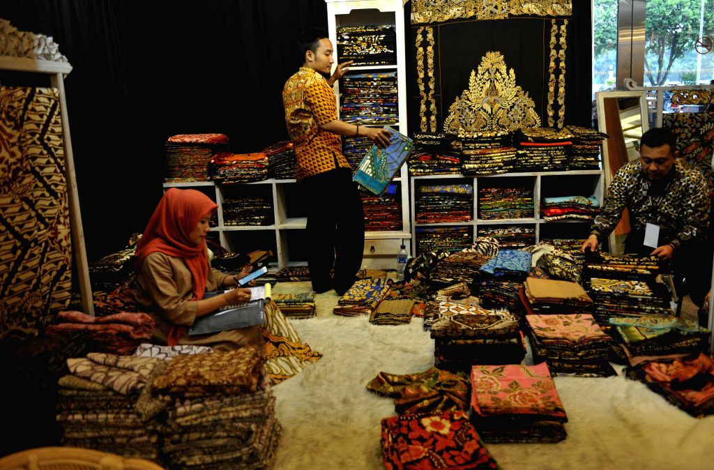 JAKARTA, Oct. 11, 2017 - Traders waits for visitors at a booth during the Crafina 2017 trade fair in Jakarta, Indonesia, Oct. 11, 2017. The trade fair featuring various ethnic Indonesian handicrafts ...