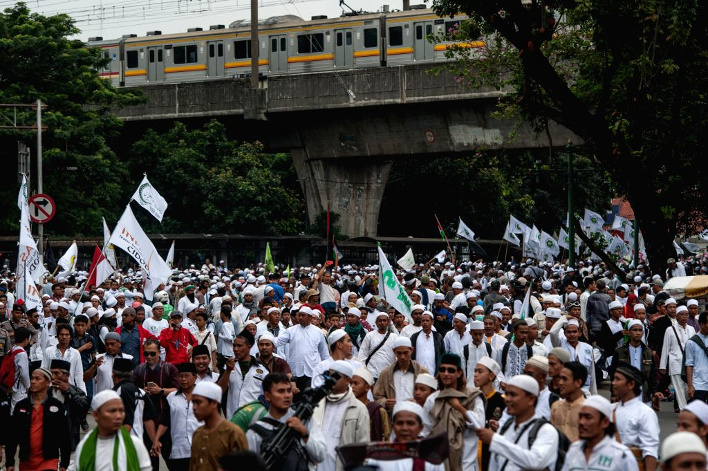 JAKARTA, Oct. 14, 2016 - Indonesian Muslims march during a rally against Jakarta Governor Basuki Tjahaja Purnama, in Jakarta, Indonesia, Oct. 14, 2016. Thousands of Indonesian Muslims attended a ...