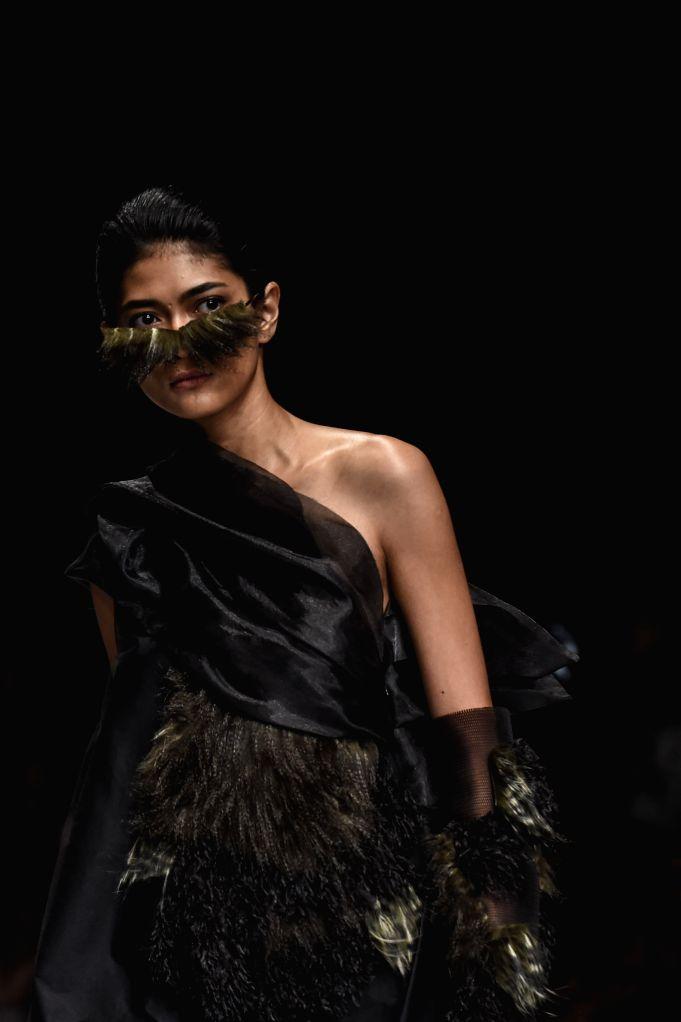 JAKARTA, Oct. 25, 2019 - A model presents a creation of Jesslyn Halim during Jakarta Fashion Week 2020 in Jakarta, Indonesia, on Oct. 25, 2019.
