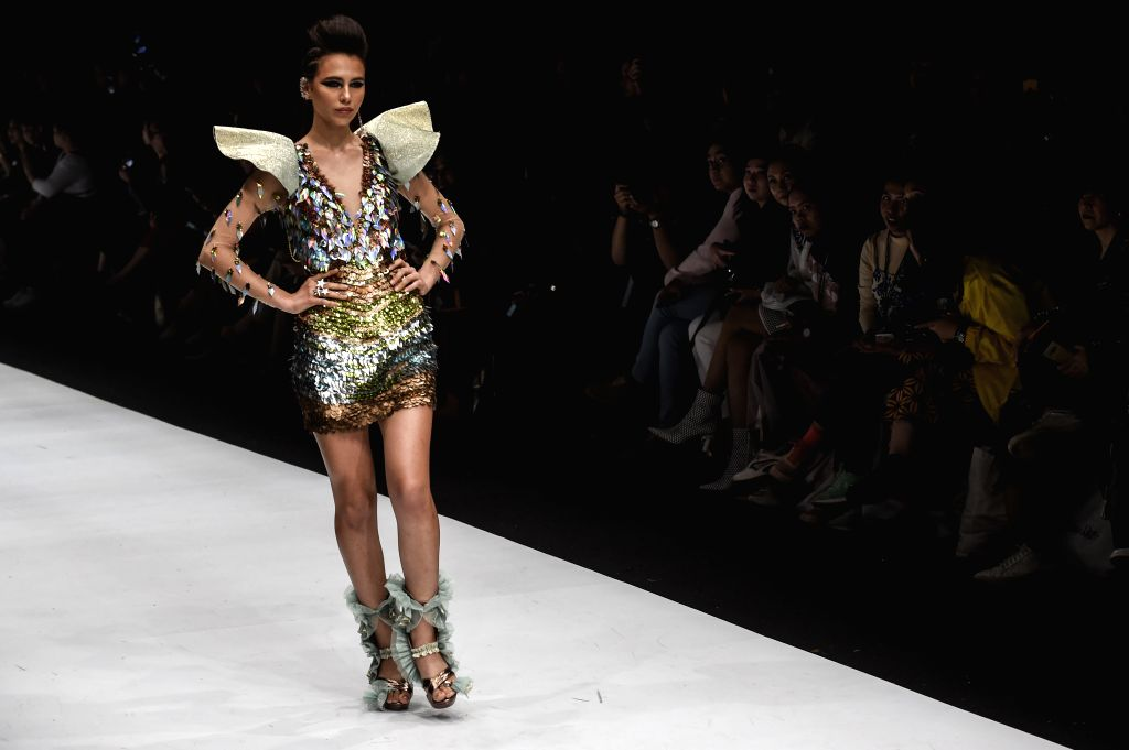 JAKARTA, Oct. 25, 2019 - A model presents a creation of Diana M Putri during Jakarta Fashion Week 2020 in Jakarta, Indonesia, on Oct. 25, 2019.