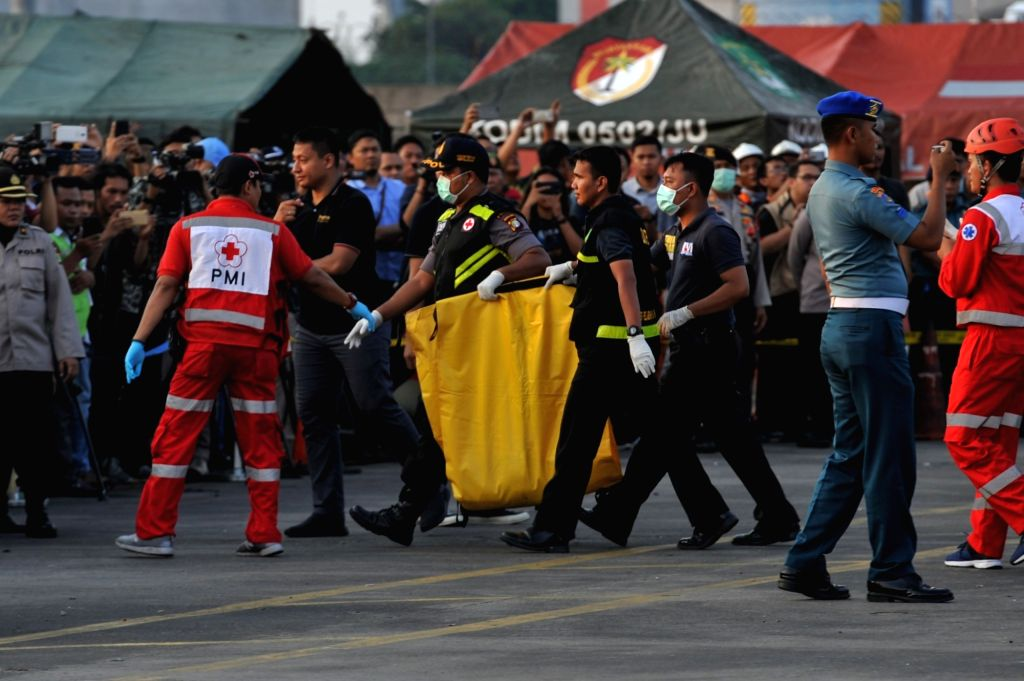 JAKARTA, Oct. 29, 2018 - Search and Rescue officers move the body bags containing victims of the Lion Air JT610 that crashed into the sea off Karawang of West Java province at the joint base of ...