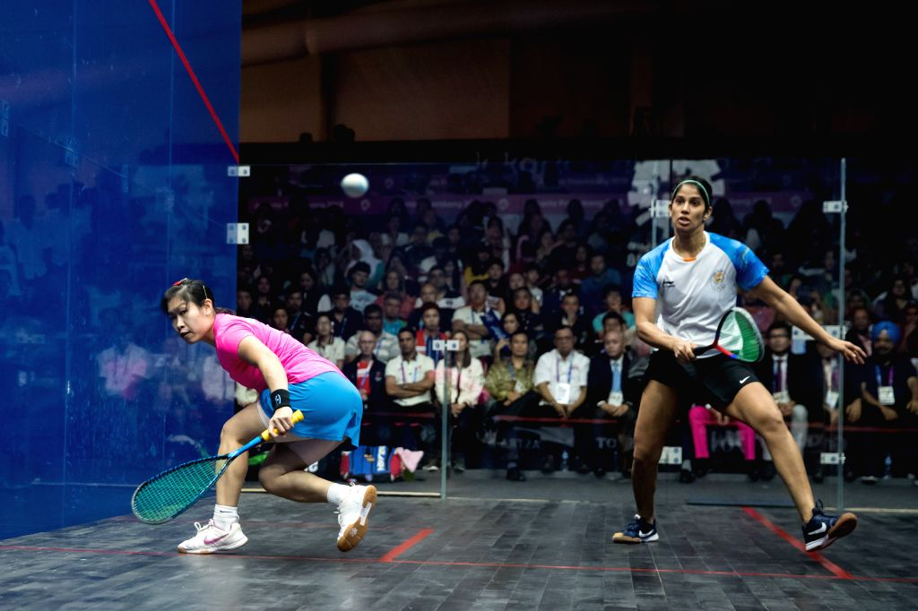 JAKARTA, Sept. 1, 2018 - Au Wing Chi Annie (L) of China's Hong Kong competes against Joshana Chinappa of India during the Squash Women's Team Gold Medal Match at the 18th Asian Games in Jakarta, ...