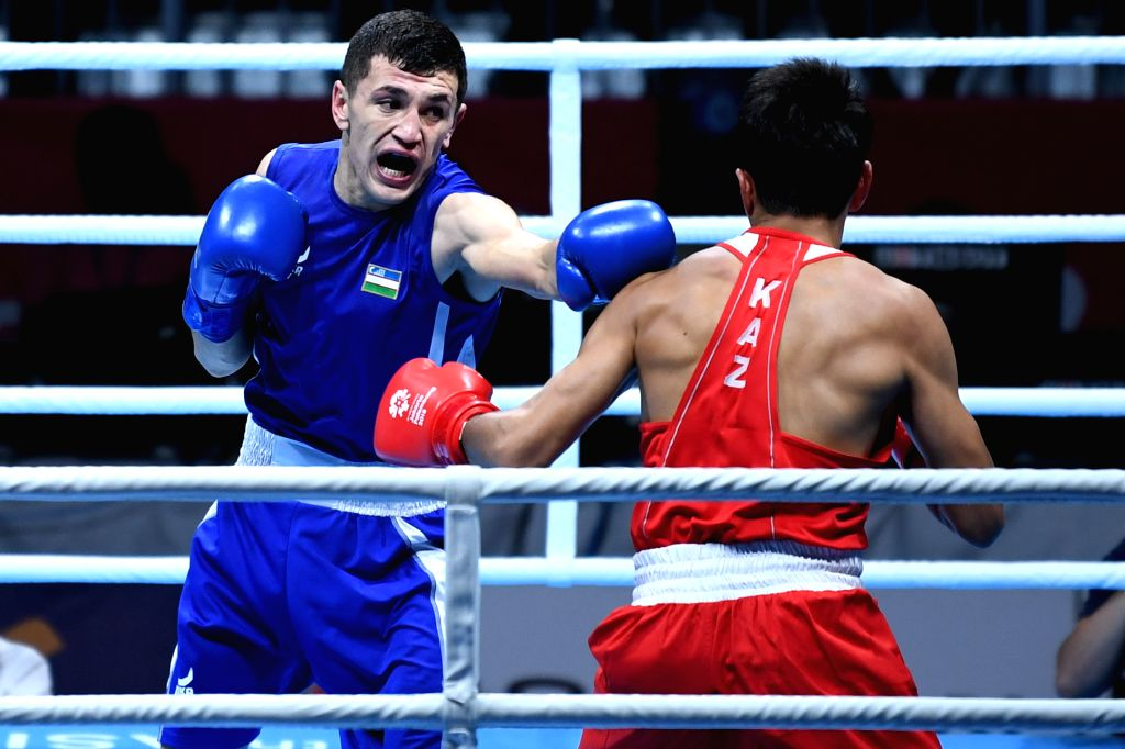 JAKARTA, Sept. 1,2018 - Bobo Usmon Baturov (L) of Uzbekistan competes against Aslanbek Shymbergenov of Kazakhstan during Men's Welter 69kg Boxing Final match at the 18th Asian Games in Jakarta, ...