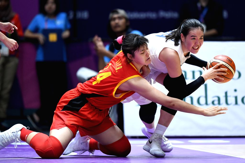 JAKARTA, Sept. 1, 2018 - Chinese player Li Yueru (L) competes during women's basketball final between China and the unified team of the Democratic People's Republic of Korea (DPRK) and South Korea at ...