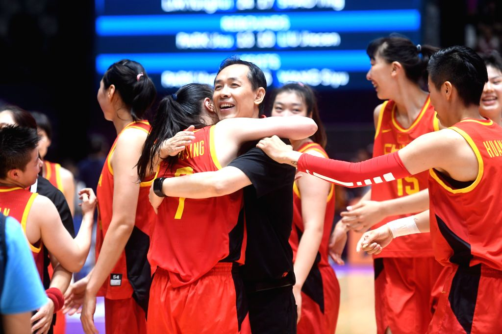 JAKARTA, Sept. 1, 2018 - Chinese players hug their head coach Xu Limin after winning women's basketball final between China and the unified team of the Democratic People's Republic of Korea (DPRK) ...