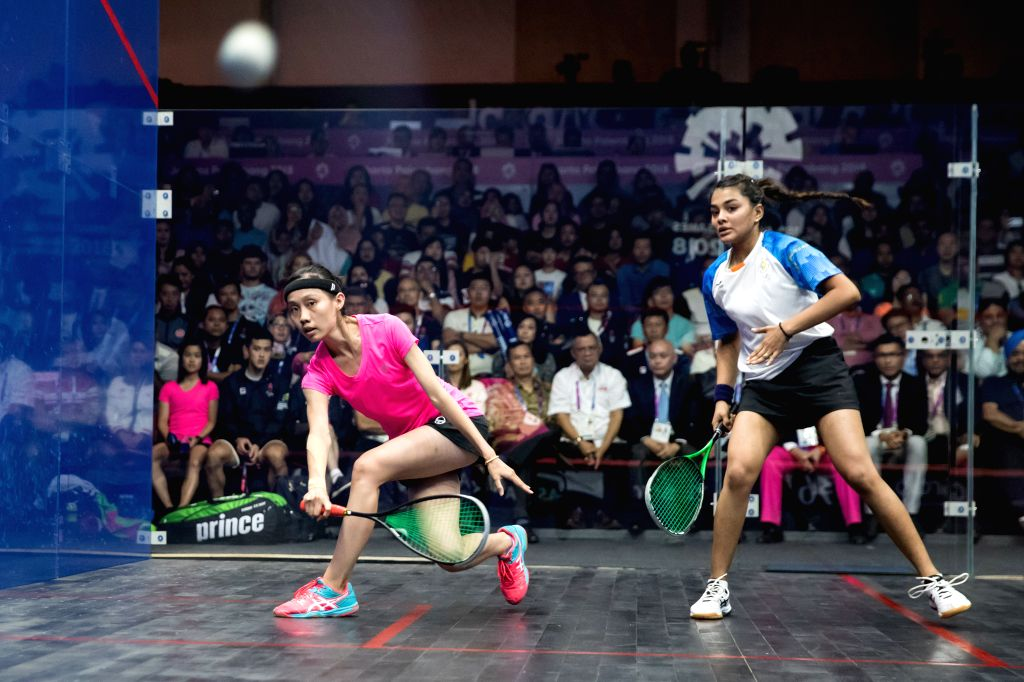 JAKARTA, Sept. 1, 2018 - Ho Tze Lok (L) of China's Hong Kong competes against Sunayna Kuruvilla of India during the Squash Women's Team Gold Medal Match at the 18th Asian Games in Jakarta, Indonesia, ...