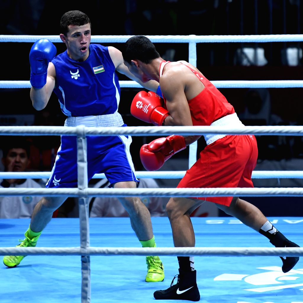 JAKARTA, Sept. 1,2018 - Israil Madrimov (L) of Uzbekistan competes against Abilkhan Amankul of Kazakhstan during Men's Middle 75kg Boxing Final match at the 18th Asian Games in Jakarta, Indonesia, ...