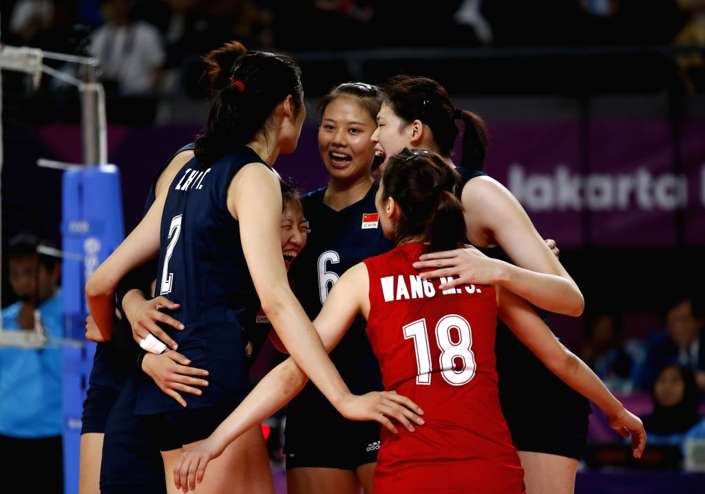 JAKARTA, Sept. 1, 2018 - Players of China celebrate during women's volleyball final between China and Thailand at the 18th Asian Games 2018 in Jakarta, Indonesia, Sept. 1, 2018.