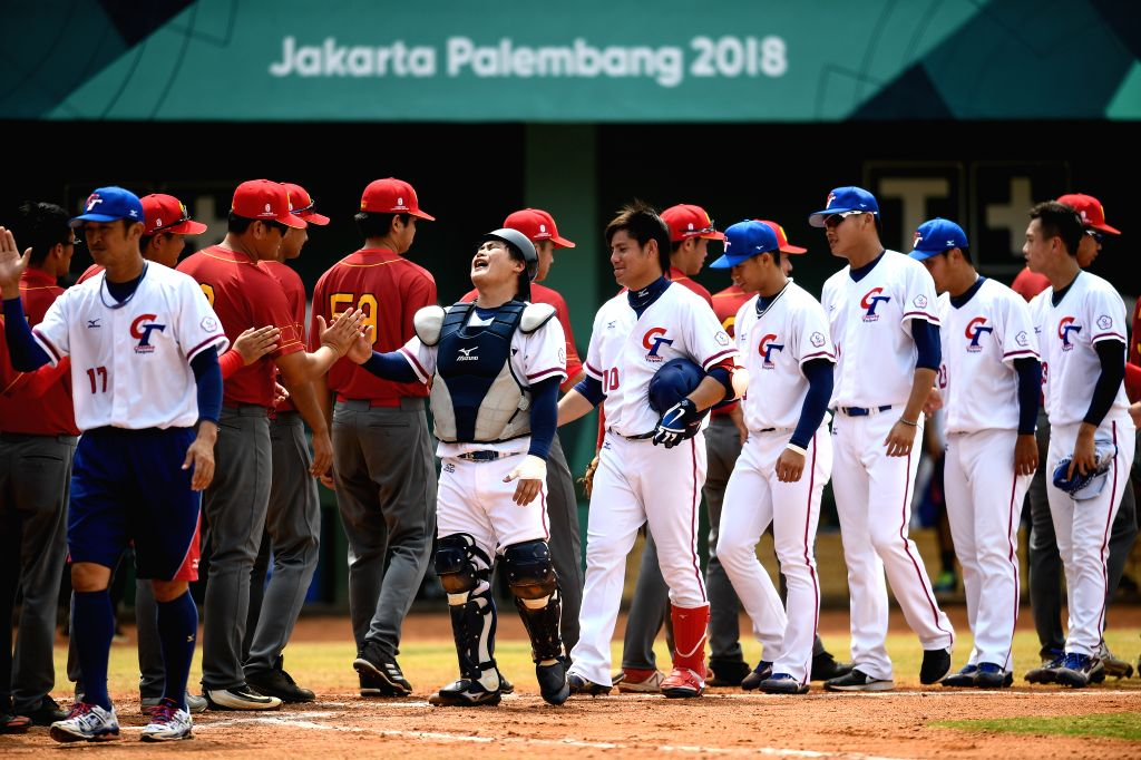 JAKARTA, Sept. 1, 2018 - Players of Chinese Taipei and players of China greet each other after Baseball Men's Team Bronze Medal Match between China and Chinese Taipei at the 18th Asian Games in ...