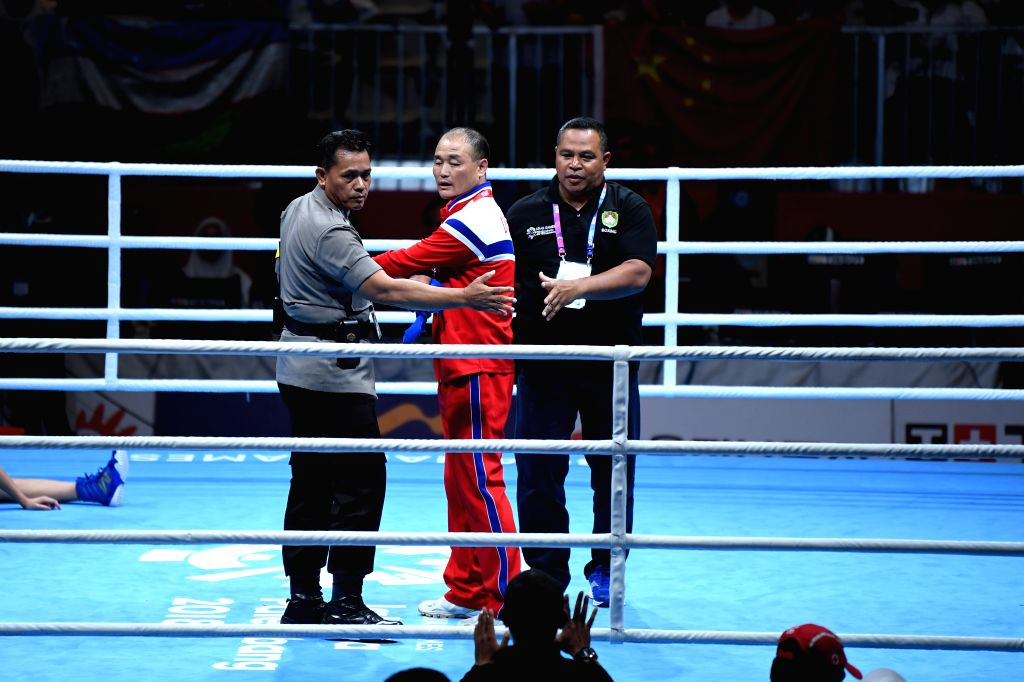 JAKARTA, Sept. 1, 2018 - Staff members try to persuade a coach from the Democratic People's Republic of Korea (DPRK) to leave the venue after Women's Fly (51kg) Final of Boxing at the 18th Asian ...
