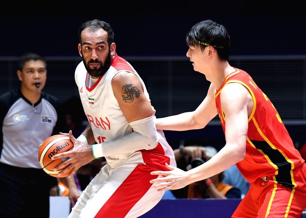 JAKARTA, Sept. 1, 2018 - Wang Zhelin (R) of China competes during men's basketball final between China and Iran at the 18th Asian Games 2018 in Jakarta, Indonesia, Sept. 1, 2018.