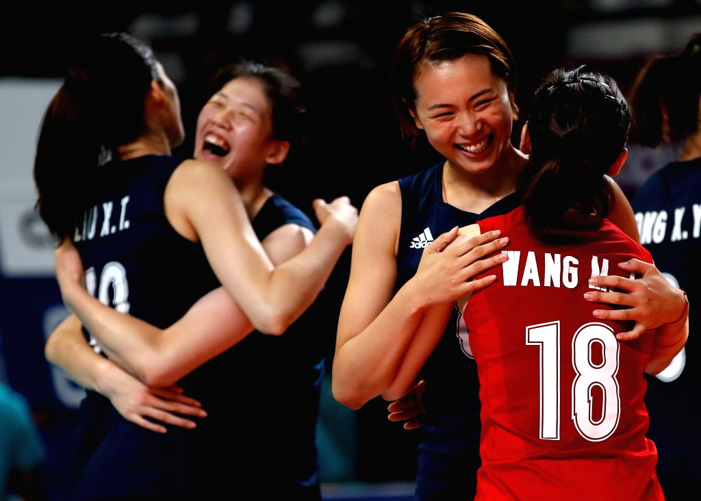 JAKARTA, Sept. 1, 2018 - Zeng Chunlei (2nd R) and Wang Mengjie (1st R) of China celebrate after winning women's volleyball final between China and Thailand at the 18th Asian Games 2018 in Jakarta, ...