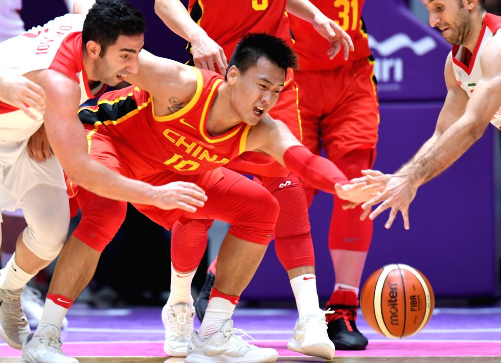 JAKARTA, Sept. 1, 2018 - Zhao Rui (C) of China competes during men's basketball final between China and Iran at the 18th Asian Games 2018 in Jakarta, Indonesia, Sept. 1, 2018.