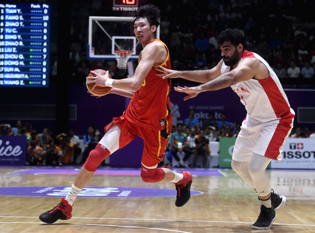 JAKARTA, Sept. 1, 2018 - Zhou Qi (L) of China competes during men's basketball final between China and Iran at the 18th Asian Games 2018 in Jakarta, Indonesia, Sept. 1, 2018.