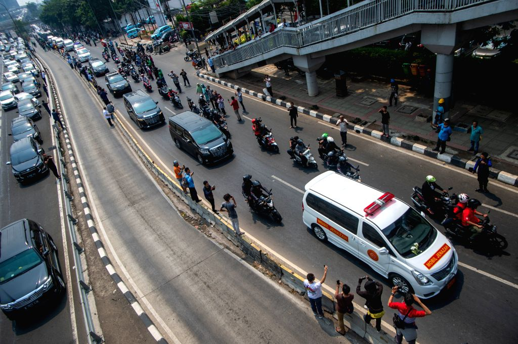 JAKARTA, Sept. 12, 2019 - A hearse carrying the body of the former Indonesia's President Bacharuddin Jusuf Habibie passes the main road to the graveyard of the Kalibata Heroes Cemetery, in Jakarta, ...