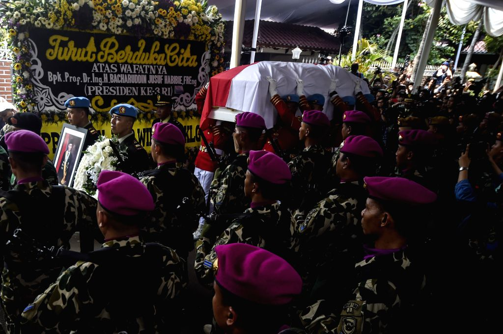 JAKARTA, Sept. 12, 2019 - Army personnel carry a coffin with the body of former president Bacharuddin Jusuf Habibie during the funeral in Jakarta, Indonesia. Sept. 12, 2019. Bacharuddin Jusuf Habibie ...