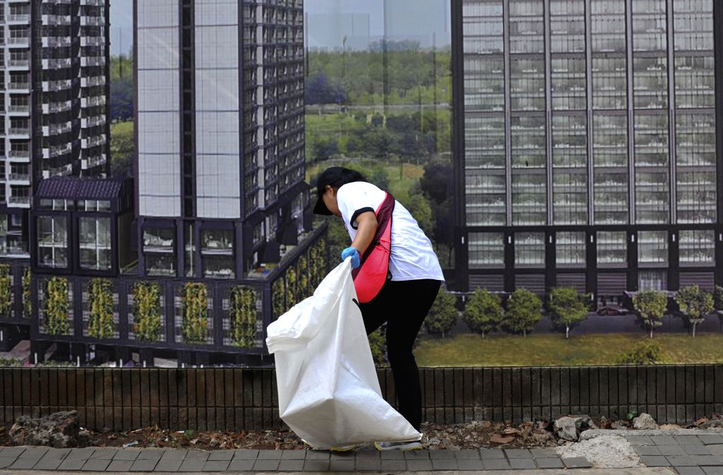 JAKARTA, Sept. 15, 2018 - A volunteer participates in a cleaning activity to mark the World Cleanup Day in Jakarta, Indonesia, Sept. 15, 2018.