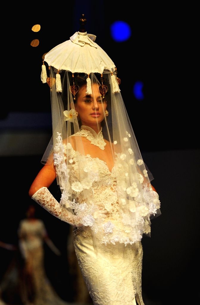 "A model presents a creation by Indonesian designer Anne Avantie during the 25th year of Anne Avantie Creation with the theme ""Merenda Kasih"" in Jakarta, .."