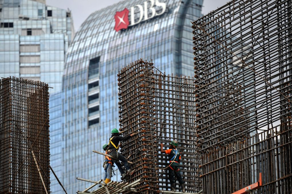 Workers work on the construction site in Jakarta, Indonesia, Dec. 8, 2014. The World Bank cut Indonesia's economic growth projection next year to 5.2 percent from the initial forecast of 5.6
