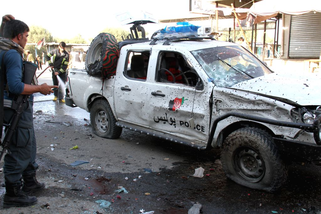 JALALABAD (AFGHANISTAN), June 13, 2019 Members of Afghan security forces inspect the site of a suicide bombing in Jalalabad city of Nangarhar province, Afghanistan, on June 13, 2019. Nine ...