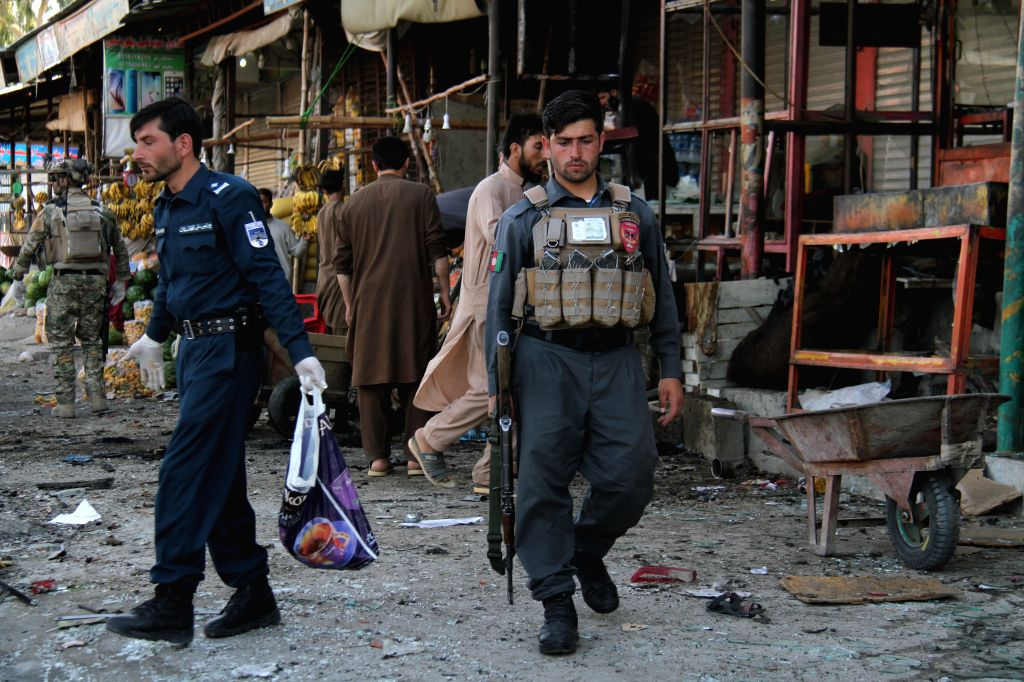 JALALABAD (AFGHANISTAN), June 13, 2019 (Xinhua) -- Members of Afghan security forces inspect the site of a suicide bombing in Jalalabad city of Nangarhar province, Afghanistan, on June 13, 2019. Nine people were confirmed dead and 11 others sustained