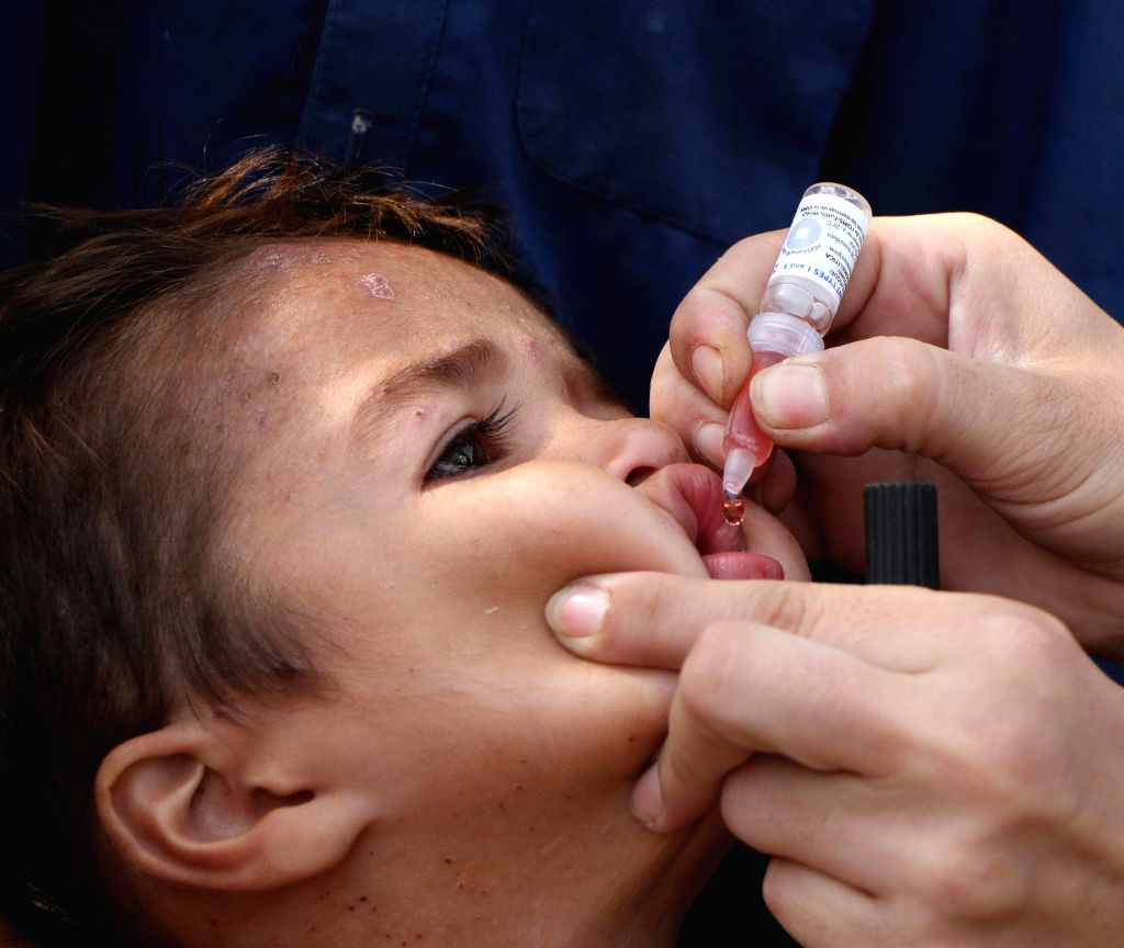 JALALABAD, Aug.15, 2017 - A health worker feeds a child with polio vaccine during an anti-polio campaign in Jalalabad, capital of Nangarhar province, Afghanistan, Aug. 15, 2017.  A three-day ...