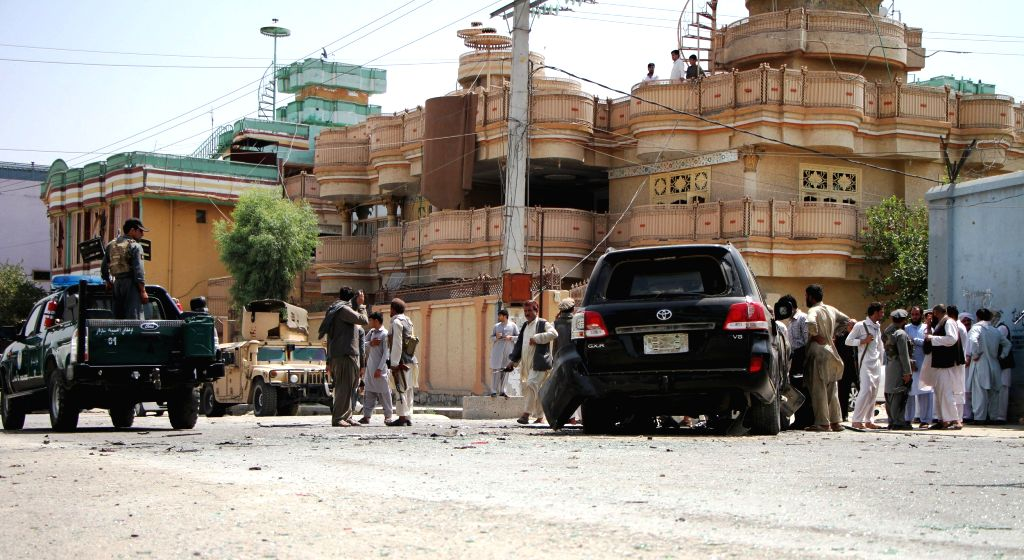 JALALABAD, July 2, 2016 - Afghan security force members stand guard at the site of a suicide attack in Jalalabad of Nangarhar province, Afghanistan, July 2, 2016. Two civilians and a suicide bomber ...