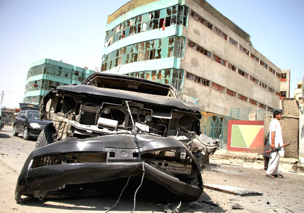 JALALABAD, July 2, 2016 - Photo taken on July 2, 2016 shows a damaged car at the site of a suicide attack in Jalalabad of Nangarhar province, Afghanistan. Two civilians and a suicide bomber were ...