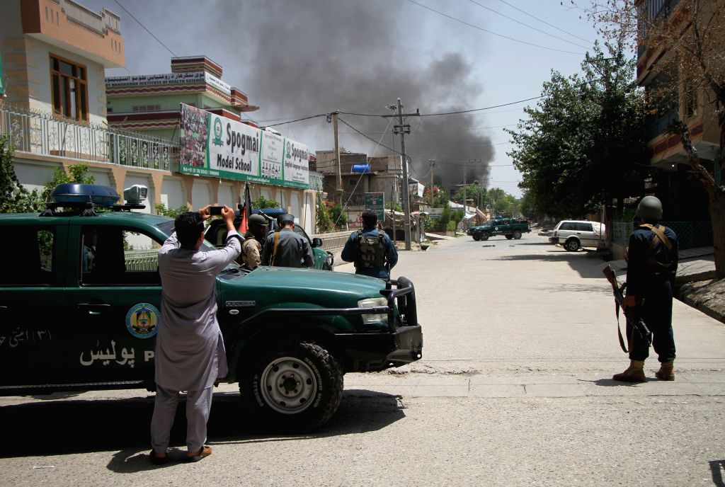 JALALABAD, July 28, 2018 - Photo taken on July 28, 2018 shows the smoke rise from the site of an attack in Jalalabad, Afghanistan. An explosion ripped through a road in Jalalabad, an eastern town in ...