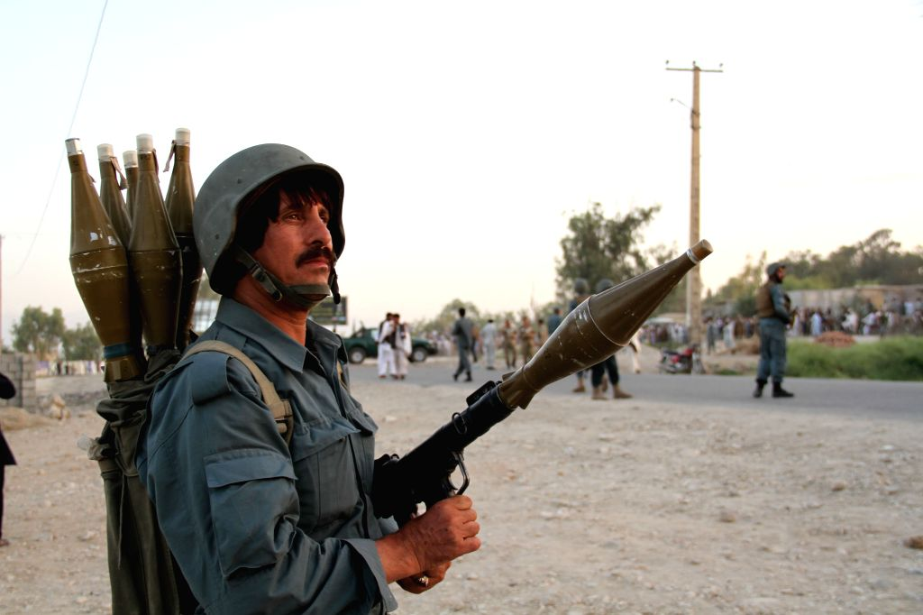 A policeman stands guard by the site of blast in Jalalabad, Afghanistan on June 21, 2014. Four people were killed and three others wounded Saturday in a bomb ...