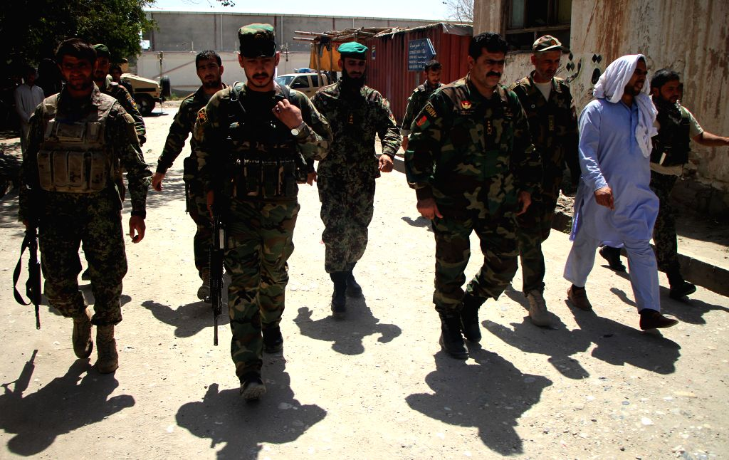 JALALABAD, June 8, 2018 - Afghan security forces members walk at the site of an attack in Jalalabad city, capital of Nangarhar province, Afghanistan, June 8, 2018. One policeman and an assailant were ...